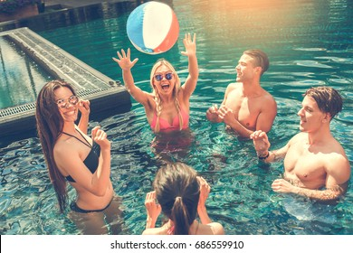 Group of friends together in the swimming pool leisure