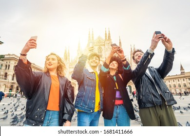 Group of friends tourist taking photos or selfie in front of Milan cathedral - memories, travel destination, technology concept