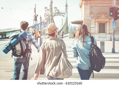 A group of friends, traveling in the city