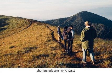 group friends trekking on mountain in morning in vintage style