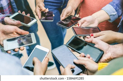 Group of friends using smart mobile phones app - Teenagers addiction to new technology trends - Concept of youth, tech, social and friendship - Focus on right girl hand with fingernail polish