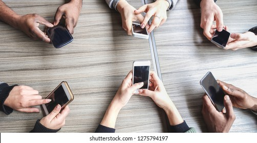 Group of friends using smartphone - People hands view having fun with mobile phones - Technology trends, and social networks app concept - Main focus on left bottom hands cellphones