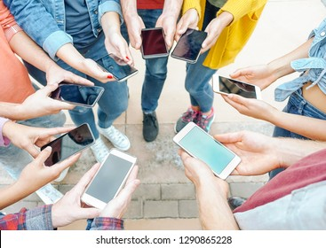 Group of friends using their smart mobile phones - Millennial young people addicted to new technology trends - Concept of people, generation z, tech, social media network and youth lifestyle