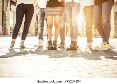 group of friends walking in the city center. concept about people, different styles, fashion trends and urban lifestyle