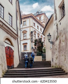 group of friends walking in the old city of Prague