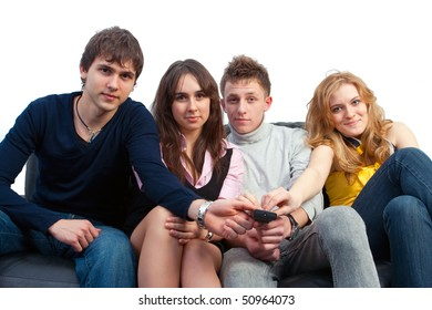 The group of friends watches TV sitting on a sofa