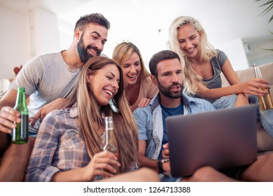 Group of friends watching football game at home.