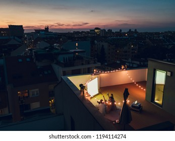 Group of friends watching movie at the rooftop