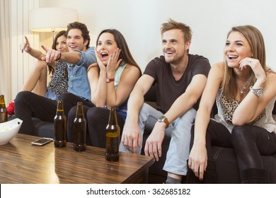 Group of friends watching TV match and cheering