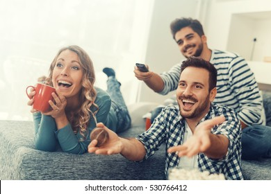 Group of friends watching TV match and having fun together.