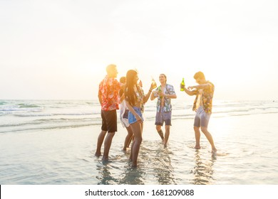 A group of friends who party and play fun on the beach. Lifestyle and Travel concept, Summer, Beach, Sea and Friendship concept.
