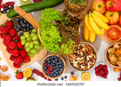 Group Fruits Breakfast mixed vegetables with salad bowl, nuts bowl, strawberry, banana, and pineapple, orange juice,  vitamin c in food  nature for health and diet in the top view on the wood table.