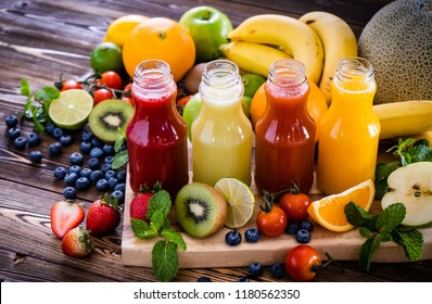 Group of fruits and juices placed on the table are healthy foods that may lower cholesterol,lower blood pressure and stroke risk,help glucose control,disrupt osteoporosis,and reduce the risk of cancer