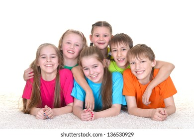 Group funny children in colorful t-shirts playing together on white background