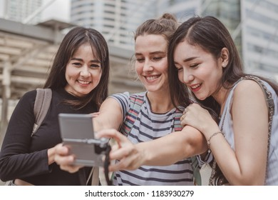 Group of funny girl friends taking a selfie at the some place, smiling and fun, ideas for travel, vacation, holiday, lifestyle, meeting, best friends and great time concept.