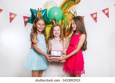 Group of funny kids celebrate birthday party together