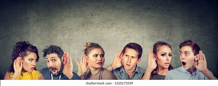 Group of funny people, women and men holding hand near ear listening to interesting news latest gossip