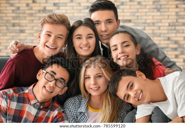 Group of funny teenagers indoors