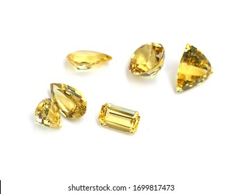Group of gemstone yellow sapphire variety shape on white paper background with selective focus