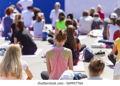 group girl yoga in the park summer