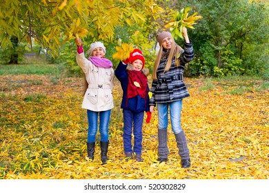 group of girls in autumn park with leafs smiling, vacation, autumn, outdoors