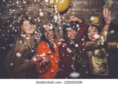 Group of girls celebrating and having fun the club. Concept about women night out