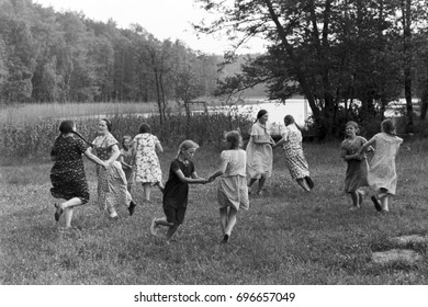 Group of girls dancing in pairs on grass