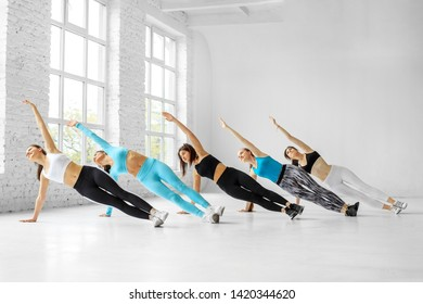 A group of girls engaged in fitness in the gym. The concept of sports, a healthy lifestyle, fitness, stretching and dancing.