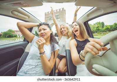 Group of girls having fun in the car. Concept about people and transportation