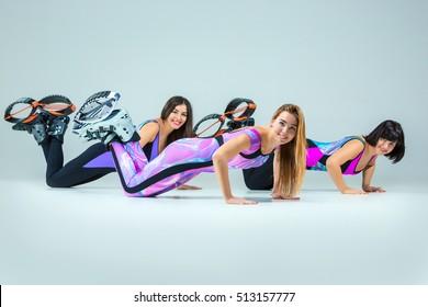 The group of girls, jumping on kangoo training