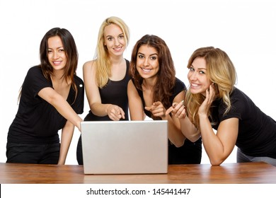 Group of girls pointing at a laptop with white background