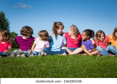 Group of Girls Sitting Together Outside - Unity, Friendship