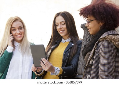 group of girls with tablet outdoors