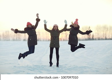 group of girls winter nature fun jump