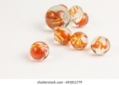 group of glass marbles in red