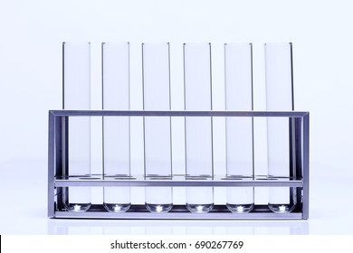 Group of Glass Tube Empty Laboratory on Stainless Steel Stand, studio lighting white background isolated copy space, closeup