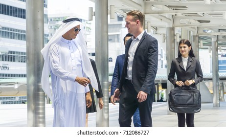 group of global business people man and woman talk and shake hands for business negotiations in feeling success and happy with the city space background in the outdoor