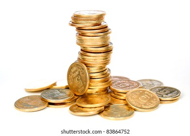Group of Gold coins tower on white.