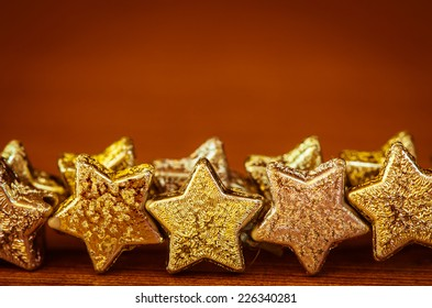 group of golden stars on brown background