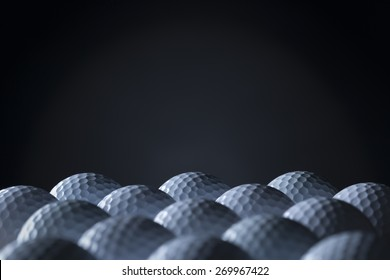 Group of golf balls arranged in lines with empty black copy space for text.