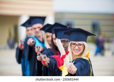group of graduates celebrating outdoors