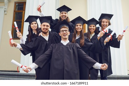 A group of graduates smiling