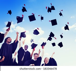 Group Of Graduating Student Throwing Caps In The Air