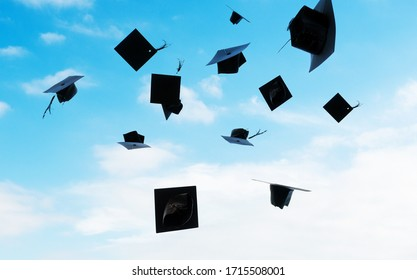 Group of graduation caps thrown in the air.
