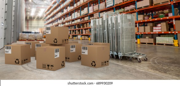 Group of graphic cardboard boxes against trolleys and cardboard boxes in warehouse