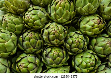 group of green artichoke flower buds