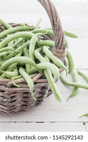 Group of green beans on white table