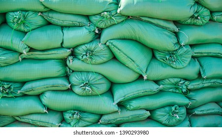 Group of green sandbags for flood control.
