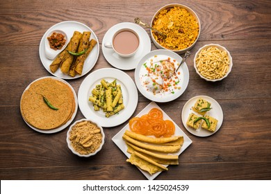 Group of Gujarati snacks like jalebi-fafda, thepla, khaman dhokla, aloo bhujiya, khandvi,khakra, dahi vada, gathiya with hot tea
