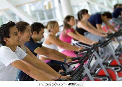 Group of gym people exercising on machines